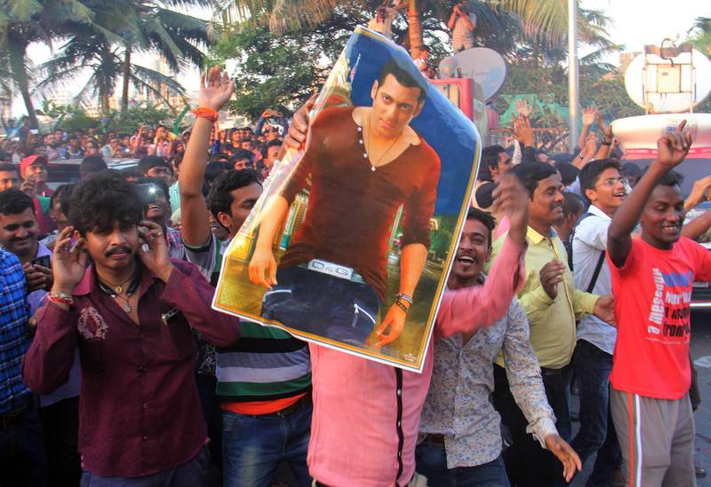 MUMBAI, INDIA - DECEMBER 10: Fans celebrate, burst crackers and distribute sweets outside Bollywood actor Salman Khan's residence at Bandra after he was acquitted in 2002 hit-and-run case, on December 10, 2015 in Mumbai, India. Salman Khan broke down as the judge pronounced the order acquitting him of all the charges in the 2002 hit-and-run case. On September 28, 2002, the actor���s car allegedly rammed into a shop in suburban Bandra. In the mishap, one person was killed and four others were injured. The court said there was not enough evidence to prove that Khan was drunk or driving his car when it rammed into the pavement in suburban Bandra on September 28, 2002, killing one person and injuring four others. The prosecution later said it will go in appeal. But troubles for Salman are not over completely as there are chances that the prosecution may question the High court���s decision in the Supreme Court. (Photo by Pramod Thakur/Hindustan Times via Getty Images)