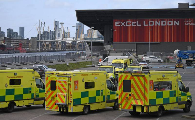 """London Ambulances are pictured parked in the car park at the ExCeL London exhibition centre in London on March 29, 2020, which has been transformed into a field hospital to be known as the NHS Nightingale Hospital, to help with the novel coronavirus COVID-19 pandemic.  Prime Minister Boris Johnson warned Saturday the coronavirus outbreak will get worse before it gets better, as the number of deaths in Britain rose 260 in one day to over 1,000. The Conservative leader, who himself tested positive for COVID-19 this week, issued the warning in a leaflet being sent to all UK households explaining how their actions can help limit the spread. """"We know things will get worse before they get better,"""" Johnson wrote. / AFP / DANIEL LEAL-OLIVAS"""