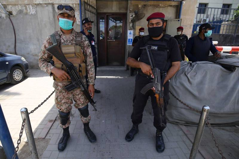 epa08517223 Pakistani security officials secure the Pakistan Stock Exchange (PSX) a day after terrorists attacked the building, in Karachi, Pakistan, 30 June 2020. At least nine people, including four attackers, were killed after insurgents belonging to Baloch Liberation Army (BLA) attacked PSX.  EPA/SHAHZAIB AKBER