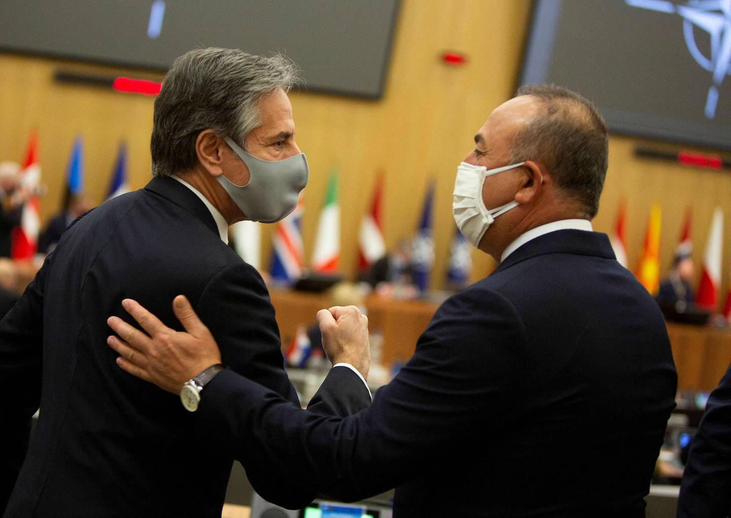 U.S. Secretary of State Antony Blinken (L) greets Turkish Foreign Minister Mevlut Cavusoglu prior to a Nato foreign ministers meeting on March 23, 2021 at the Nato headquarters in Brussels. / AFP / POOL / Virginia Mayo