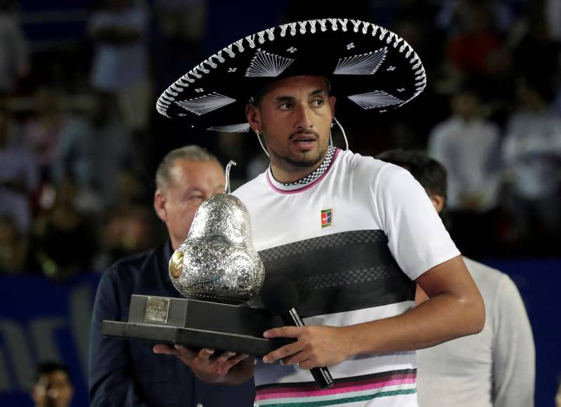 FILE PHOTO: Tennis - ATP 500 - Acapulco Open, Acapulco, Mexico - March 2, 2019    Australia's Nick Kyrgios celebrates winning the Acapulco Open with the trophy   REUTERS/Henry Romero/File Photo