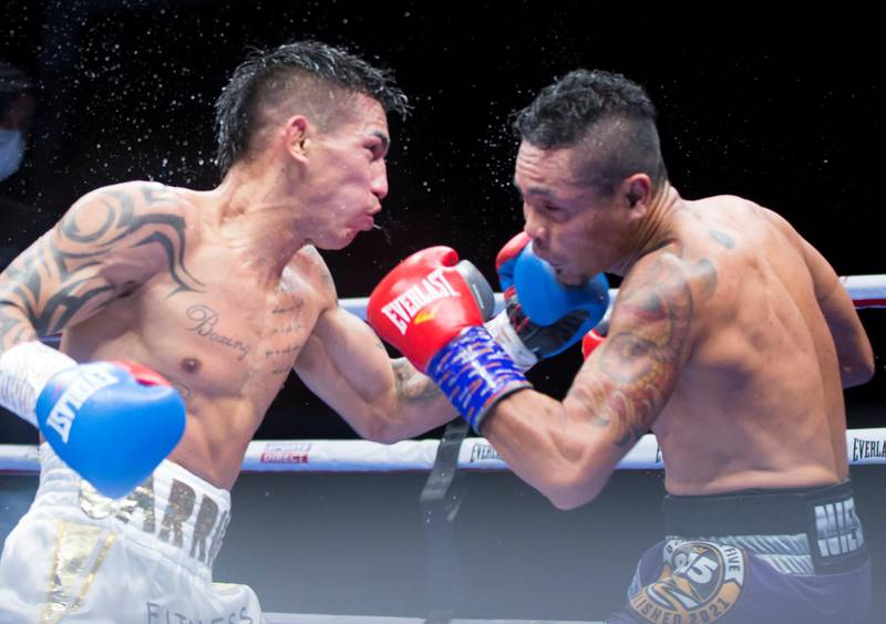 Dubai, United Arab Emirates - Donnie Nietes of the Philippines (right) at the receiving end  Pablo Carillo of Colombia at the Rotunda, Ceasar's Palace, Bluewaters Island, Dubai.  Leslie Pable for The National