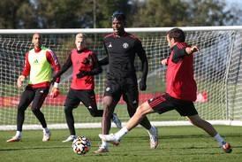 Pogba leads buoyant Man United training for Liverpool showdown