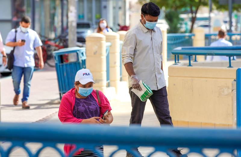 Abu Dhabi, United Arab Emirates, April 6, 2020.   Abu Dhabi residents take the underpass in front of the Al Wahda Mall.  UAE health ministry advised residents to wear a mask when they are outside, whether they are showing symptoms of Covid-19 or not. Victor Besa / The NationalSection:  NAReporter: