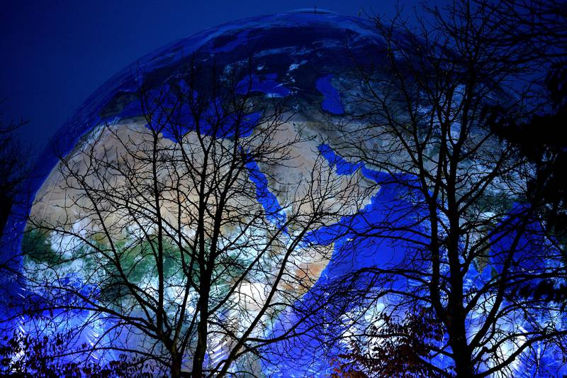 epaselect epa06314223 A blue illuminated globe at the site which will host UN Climate Change Conference COP23, in Bonn, Germany, 07 November 2017. The 23rd session of the United Nations Framework Convention on Climate Change Conference (UNFCCC), the 2017 UN Climate Change Conference COP23 will take place from 06 to 17 November in Bonn, the seat of the Climate Change Secretariat, under the presidency of Fiji.  EPA/PHILIPP GUELLAND