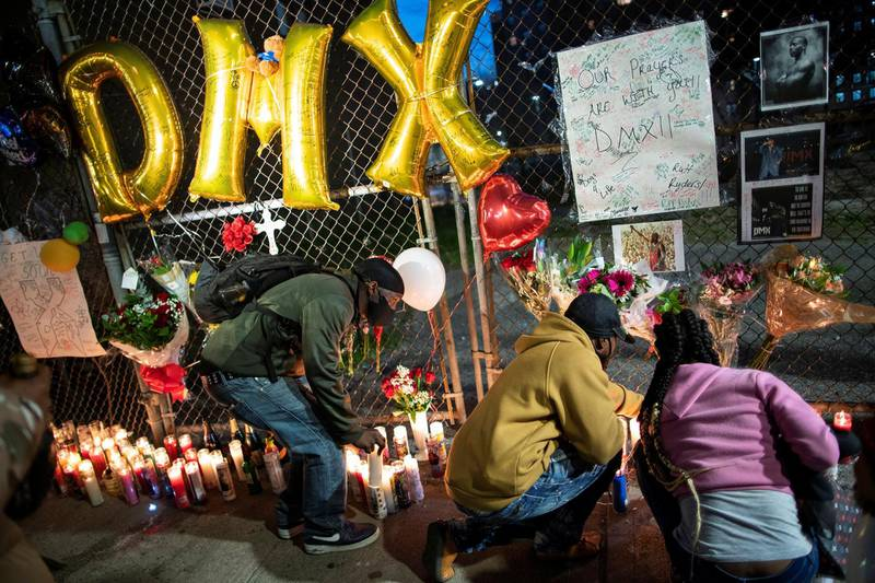 Fans light candles at a makeshift memorial for musician and actor DMX outside White Plains Hospital, after he died at the age of 50 in White Plains, New York, U.S., April 9, 2021. REUTERS/Eduardo Munoz
