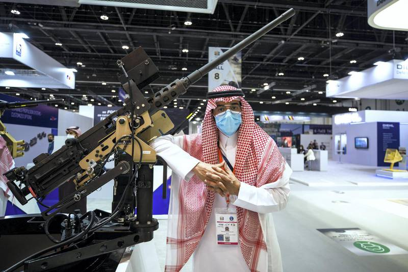 Abu Dhabi, United Arab Emirates, February 21, 2021.  Idex 2021, the first major in-person exhibition held in Abu Dhabi since the start of the Covid-19 pandemic, opened its doors to delegates on Sunday morning. --  Abdulelah Al Mohaimeed with the RFO or remote firing option 50. Cal heavy machine gun made by Wahaj of Saudi Arabia.Victor Besa / The NationalSection:  NAReporter:  John Dennehy