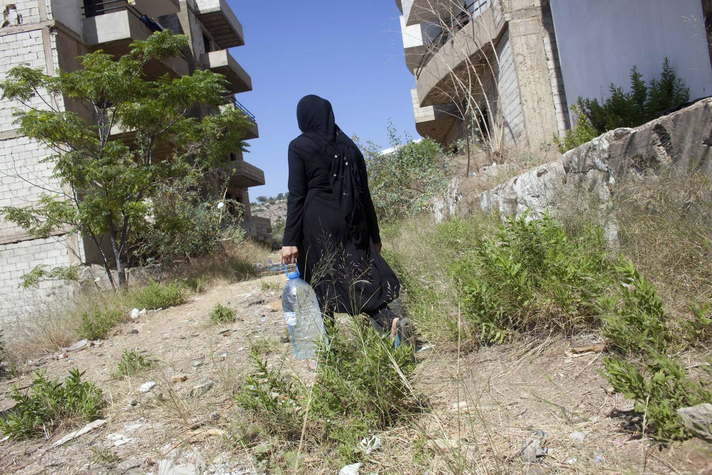 05/07/2013 near Damour, Lebanon: A Syrian mother collects water for cooking. Many of the flats in the vacation-home development lack basics like electricity and running water. Estimates have placed the number of Syrian refugees in Lebanon at well over 500,000 people. *** Local Caption ***  06292013_LM_SyrianRefugees-118.jpg