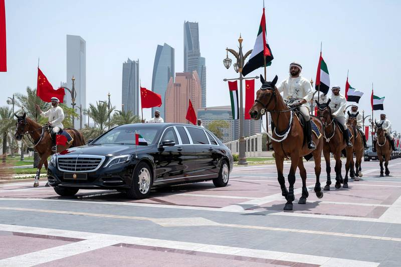 ABU DHABI, UNITED ARAB EMIRATES - July 20, 2018: Members of the UAE Armed Forces Cavalry Division escort HE Xi Jinping, President of China (in vehicle), upon his arrival at the Presidential Palace.   ( Hamad Al Mansoori for Crown Prince Court - Abu Dhabi )