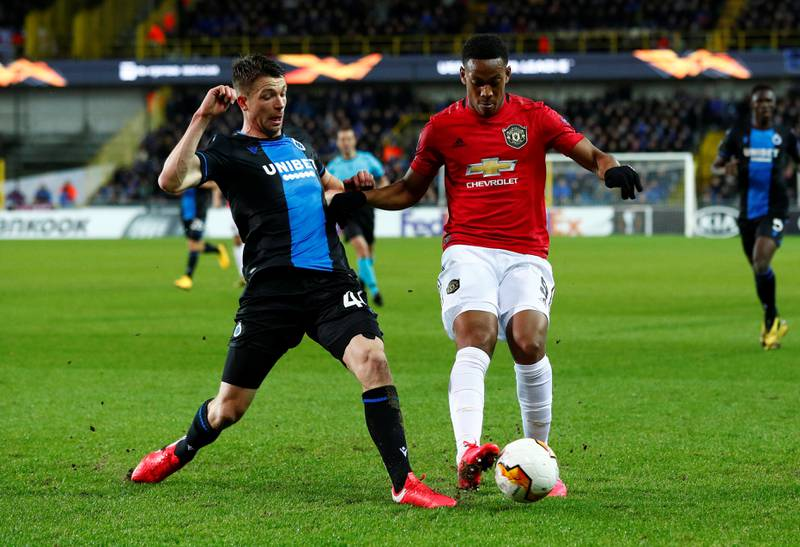 Soccer Football - Europa League - Round of 32 First Leg - Club Brugge v Manchester United - Jan Breydel Stadium, Bruges, Belgium - February 20, 2020  Manchester United's Anthony Martial in action with Club Brugge's Brandon Mechele   REUTERS/Francois Lenoir
