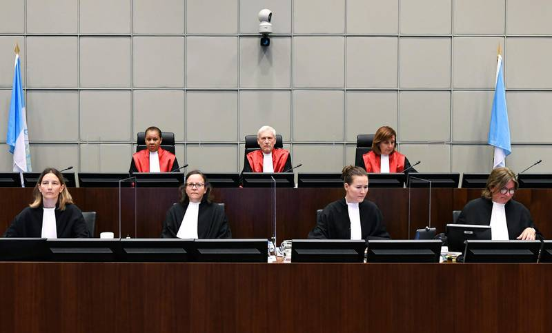 Presiding Judge, Judge David Re, top centre, with Judge Janet Nosworthy, left, and Judge Micheline Braidy, during a session of the United Nations-backed Lebanon Tribunal in Leidschendam, Netherlands Tuesday Aug. 18, 2020, where it is scheduled to hand down it's judgement in the case against four men being tried for the bombing that killed former Lebanon Prime Minister Rafik Hariri and 21 others.  The U.N.-backed tribunal in the Netherlands is to deliver verdicts in the trial held in absentia of four members of the militant Lebanese Hezbollah group accused of involvement in the 2005 truck bomb assassination of former Lebanese Prime Minister Rafik Hariri. (Piroschka Van De Wouw/Pool via AP)