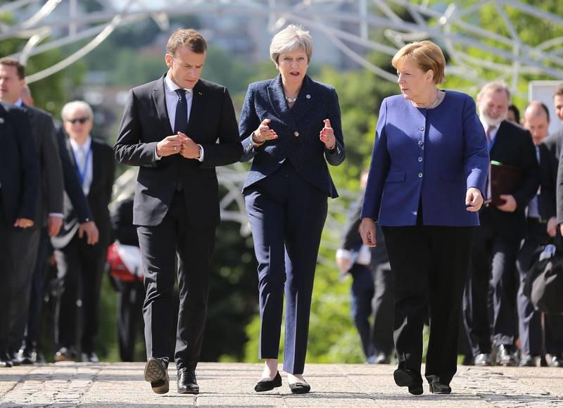 French President Emmanuel Macron, British Prime Minister Theresa May and German Chancellor Angela Merkel walk during the EU-Western Balkans Summit in Sofia, Bulgaria, May 17, 2018. REUTERS/Stoyan Nenov