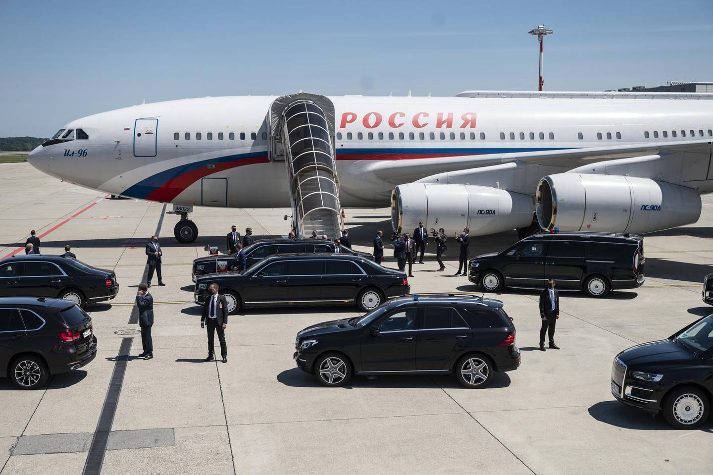 epa09275737 Russian President Vladimir Putin enters the limousine after disembarking from the presidential Ilyushin Il-96-300PU airplane as he arrives at Geneva Airport Cointrin, for a US-Russia summit in Geneva, Switzerland, 16 June 2021. US President Biden and Russian President Putin meet in Geneva on 16 June for face-to-face talks.  EPA/ALESSANDRO DELLA VALLE / POOL