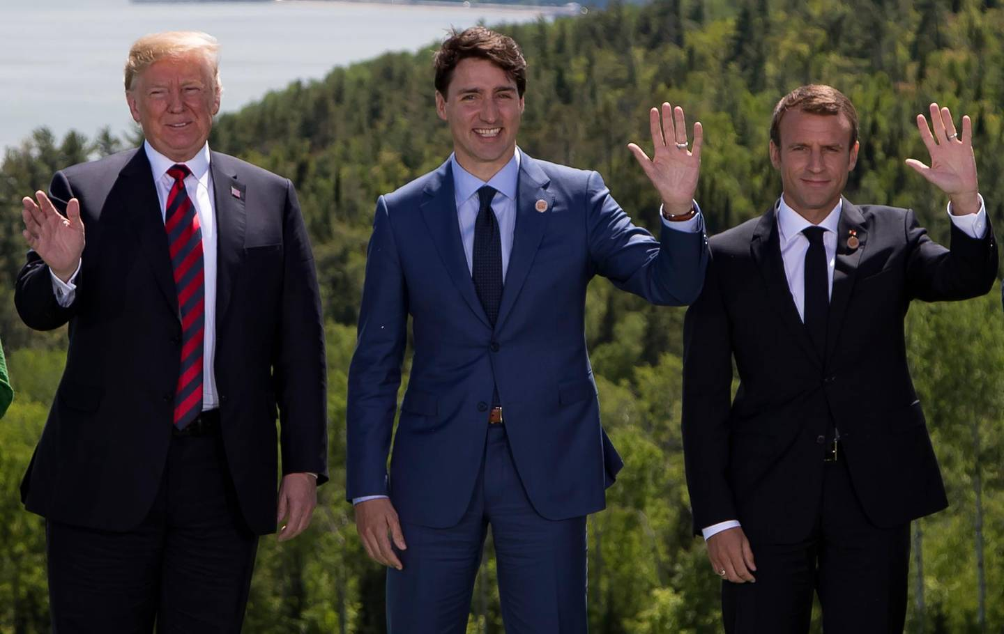 epaselect epa06794975 (L-R) US President Donald Trump, Canadian prime minister Justin Trudeau and French president Emmanuel Macron wave during the family photo at the G7 summit in Charlevoix in Canada, 08 June 2018. The G7 Summit runs from 08 to 09 June in Charlevoix, Canada.  EPA/IAN LANGSDON/POOL MAXPPP OUT