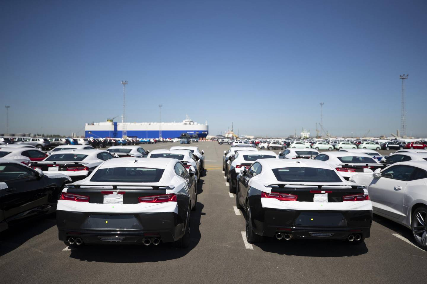 New Chevrolet Camaro automobiles, manufactured by General Motors Co., stand on the dockside before export at the Port of Zeebrugge in Zeebrugge, Belgium, on Monday, May 7, 2018. With Brexit due in 10 months, Zeebrugge embodies the repeated warnings by the U.K.'s EU partners that its departure from the bloc is a lose-lose move by adding bureaucracy for businesses and costs for consumers. Photographer: Jasper Juinen/Bloomberg