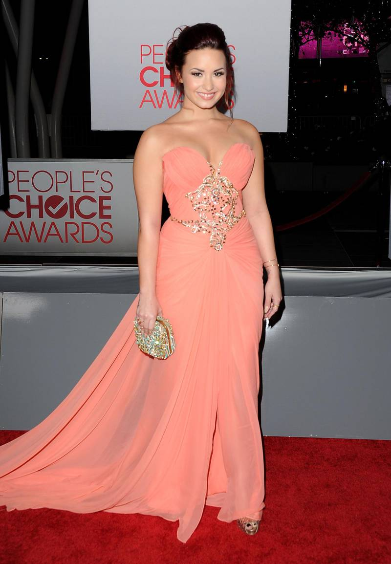 LOS ANGELES, CA - JANUARY 11: Singer Demi Lovato arrives at the 2012 People's Choice Awards held at Nokia Theatre L.A. Live on January 11, 2012 in Los Angeles, California.   Jason Merritt/Getty Images/AFP