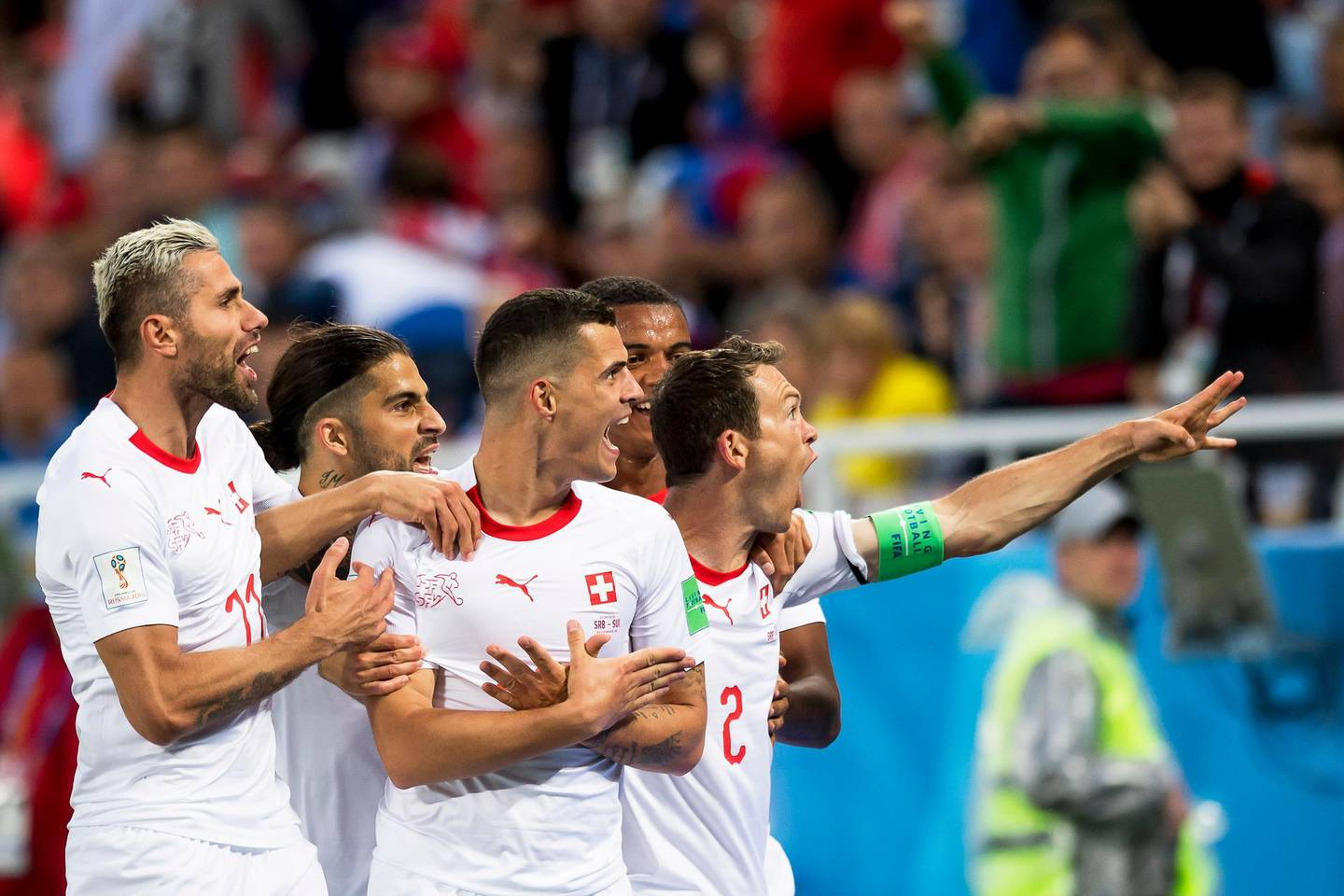 epa06831890 Switzerland's midfielder Granit Xhaka (C) celebrates with his teammates after scoring the 1-1 equalizer during the FIFA World Cup 2018 group E preliminary round soccer match between Switzerland and Serbia in Kaliningrad, Russia, 22 June 2018.   (RESTRICTIONS APPLY: Editorial Use Only, not used in association with any commercial entity - Images must not be used in any form of alert service or push service of any kind including via mobile alert services, downloads to mobile devices or MMS messaging - Images must appear as still images and must not emulate match action video footage - No alteration is made to, and no text or image is superimposed over, any published image which: (a) intentionally obscures or removes a sponsor identification image; or (b) adds or overlays the commercial identification of any third party which is not officially associated with the FIFA World Cup)  EPA/LAURENT GILLIERON   EDITORIAL USE ONLY