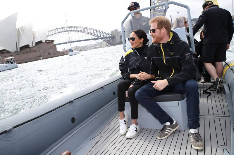 SYDNEY, AUSTRALIA - OCTOBER 21:  Prince Harry, Duke of Sussex and Meghan, Duchess of Sussex sail across Sydney harbour  at Sydney Olympic Park on October 21, 2018 in Sydney, Australia. The Duke and Duchess of Sussex are on their official 16-day Autumn tour visiting cities in Australia, Fiji, Tonga and New Zealand.  (Photo by Pool/Samir Hussein/WireImage)