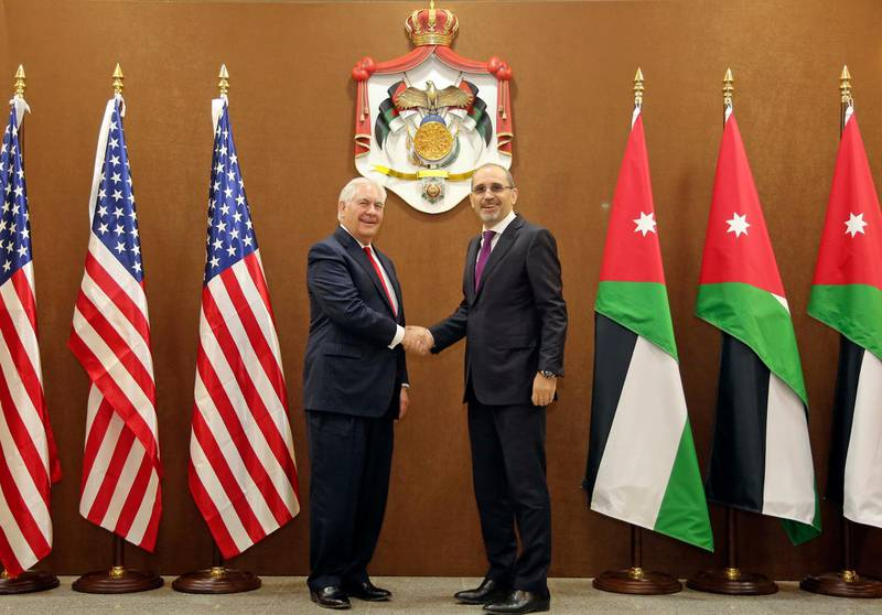 US Secretary of State Rex Tillerson, left, and Jordanian Foreign Minister Ayman Safadi, shake hands in Amman, Jordan, Wednesday Feb. 14, 2018. The Trump administration is set to boost aid to Jordan by more than $1 billion over the next five years, in spite of President Donald Trump's repeated threats to punish countries that don't agree with U.S. policy in the Middle East. (AP Photo/Raad Adayleh)