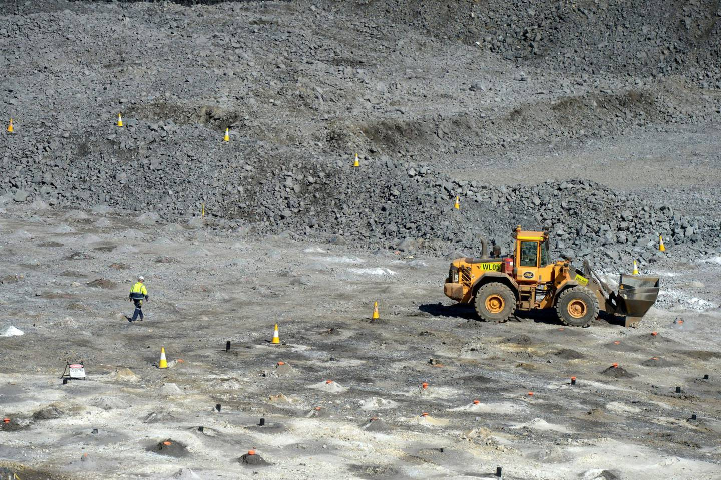 A worker set an area for explosives on a mine floor at the Bald Hill lithium mine site, co-owned by Tawana Resources Ltd. and Alliance Mineral Assets Ltd., outside of Widgiemooltha, Australia, on Monday, Aug. 6, 2018. Australia's newest lithium exporterTawana is in talks with potential customers over expansion of itsBaldHillmine and sees no risk of an oversupply that would send prices lower. Photographer: Carla Gottgens/Bloomberg