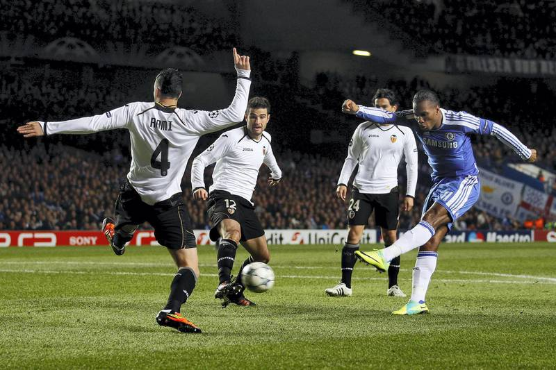 Chelsea's Didier Drogba (R) shoots to score against Valencia during their Champions League Group E soccer match at Stamford Bridge in London December 6, 2011. REUTERS/Eddie Keogh (BRITAIN - Tags: SPORT SOCCER)