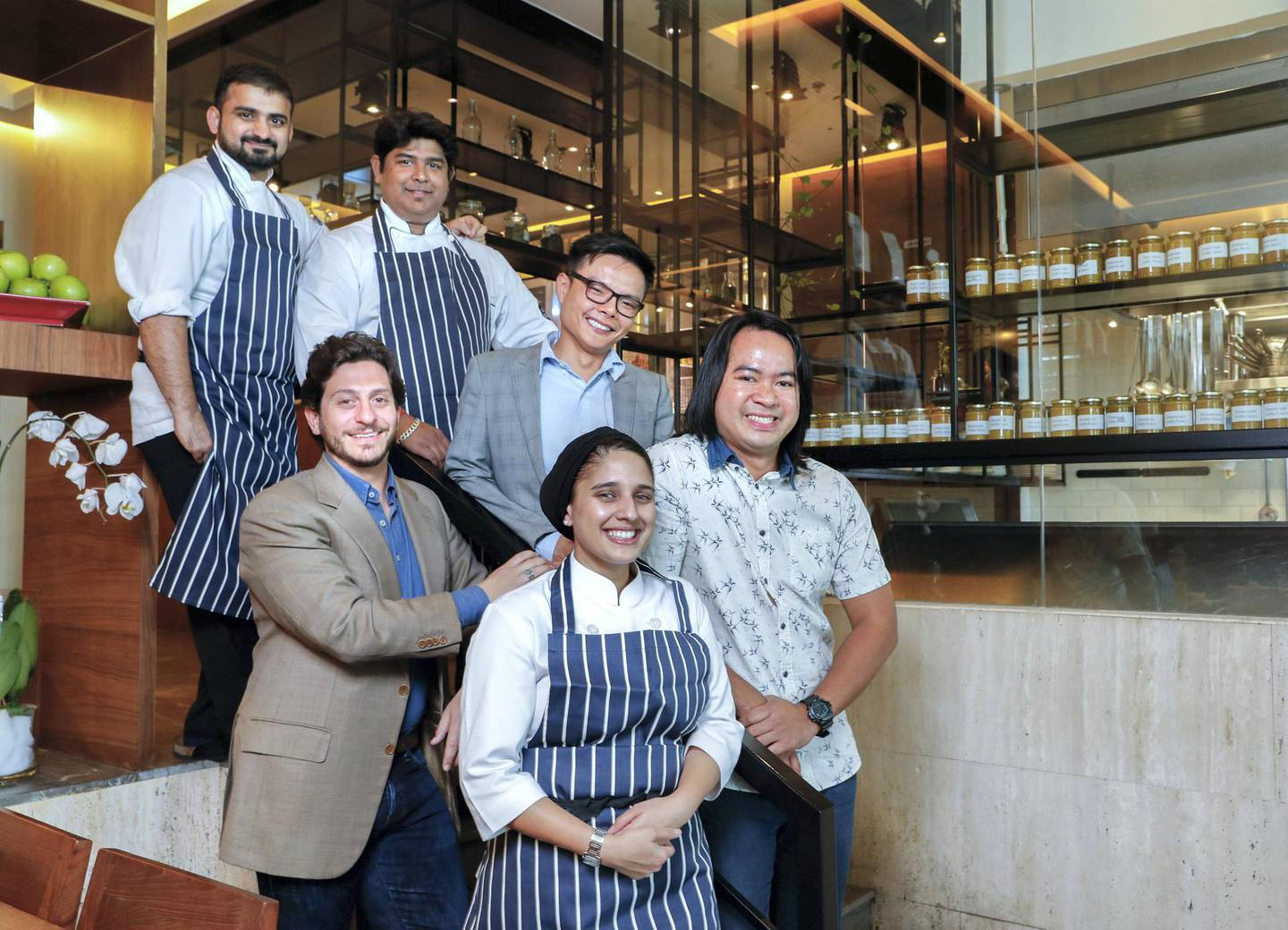 Dubai, UAE, February 19,2018.  Andre (the boss) of Baker & Spice café Al Manzil Mall Dubai  and some of his team for a feature story.  (L-R) from back row: Manish Gajara, Sumanta Roy, Adrian Chow and Deejay Leon, (front) Andre Gerschel and Aaliyah Randeree.Victor Besa / The NationalWKReporter:  Kevin Hacket