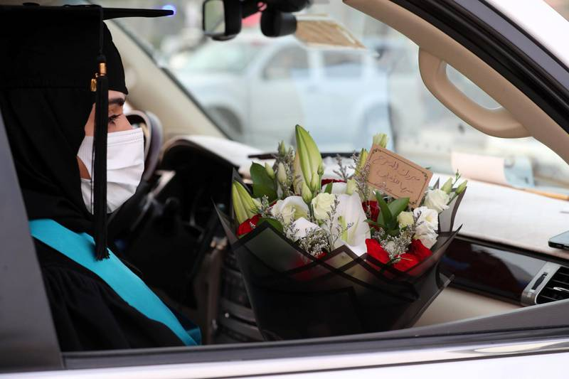 Ajman, United Arab Emirates - Reporter: Anam Rizvi. News. Afra Mohammed waits in her car before her drive through graduation from Ajman University because of Covid-19. Wednesday, February 10th, 2021. Ajman. Chris Whiteoak / The National