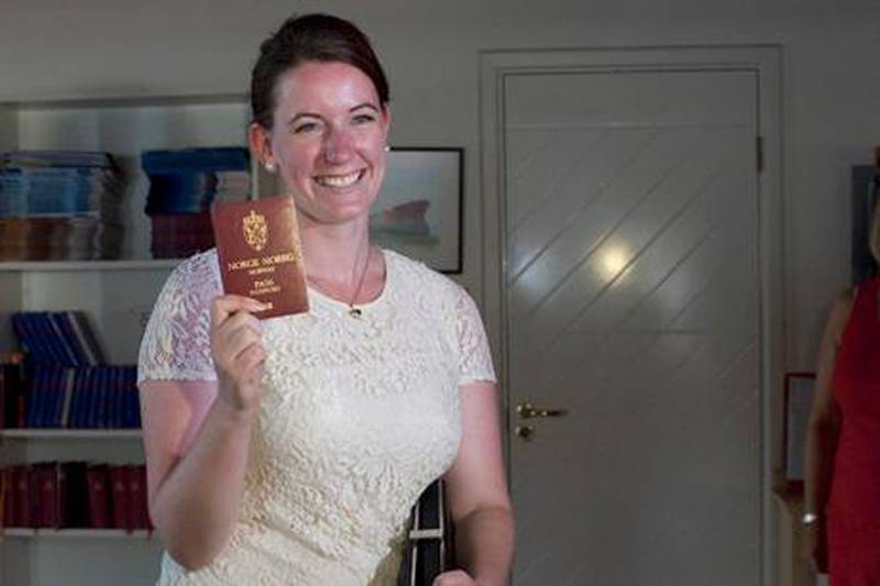 Dubai, United Arab Emirates - July 22 2013 -  Marte Dalelv walks into the Norwegian Seaman's Center displaying her passport to the press. The center, located in Bur Dubai, became her safe haven during the course of her trial and initial sentencing. She is now a free woman after being granted a full pardon from the Prosecutor's Office. For Story by Ramola Tawar.   (Razan Alzayani / The National)