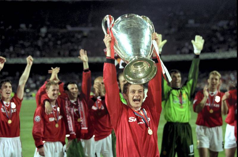 26 May 1999:  Ole Gunnar Solskjaer holds aloft the European Cup after Manchester United win the European Champions League Final against Bayern Munich in the Nou Camp Stadium, Barcelona, Spain. Manchester United won 2 - 1 with Solskjaer scoring the secondgoal, and both United goals scored during injury time, to secure the treble of League, FA Cup and European Cup. \ Mandatory Credit: Alex Livesey /Allsport