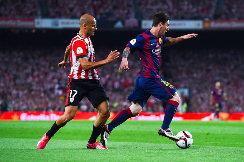 BARCELONA, SPAIN - MAY 30:  Lionel Messi of FC Barcelona competes for the ball with Mikel Rico of Athletic Club on his way to scores the opening goal during the Copa del Rey Final match between FC Barcelona and Athletic Club at Camp Nou on May 30, 2015 in Barcelona, Spain.  (Photo by David Ramos/Getty Images)