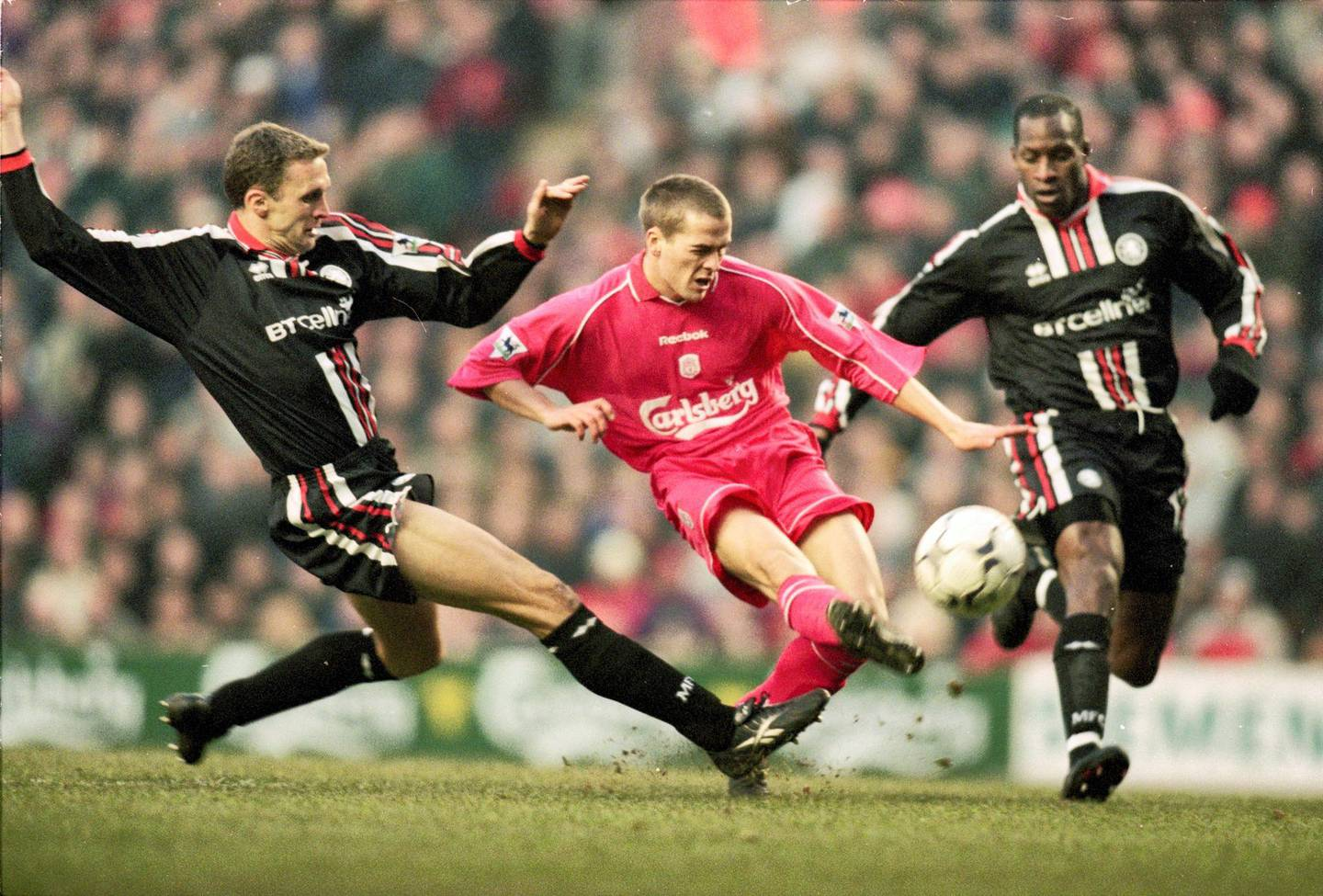 20 Jan 2001:  Michael Owen of Liverpool is closed down by Steve Vickers and Ugo Ehiogu of Middlesbrough during the FA Carling Premier League match played at Anfield in Liverpool, England. The game ended in a 0-0 draw. \ Mandatory Credit: Gary M Prior/Allsport