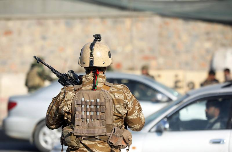 epa08005018 An Afghan National Army (ANA) officer stands guard at the scene of an attack in Kabul, Afghanistan, 18 November 2019. According to media reports, at least four soldiers were injured in back-to-back explosions outside the Kabul Military Training Center (KMTC). No group has yet claimed responsibility, media added.  EPA/JAWAD JALALI