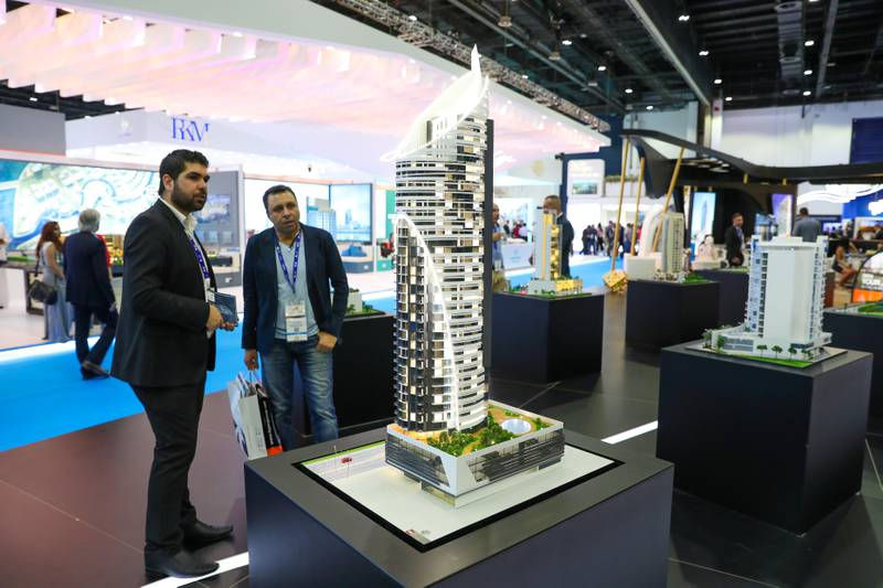 Dubai, United Arab Emirates - September 11th, 2017: Visitors at the 02 model by Tiger at the 16th addition of Cityscape Global. Monday, September 11th, 2017 at World Trade centre, Dubai.