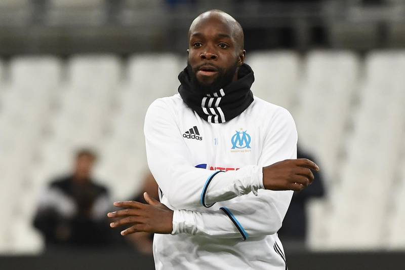 (FILES) This file photo taken on February 8, 2017 shows Olympique de Marseille's French midfielder Lassana Diarra warming up prior to the French Ligue 1 football match between Olympique de Marseille (OM) and Guingamp at the Velodrome stadium in Marseille.  Lassana Diarra, who was filmed on January 22, 2018, leaving the American Hospital of Paris after a medical check-up, is close to joining the Paris Saint-Germain football team according to several media.  / AFP PHOTO / BORIS HORVAT