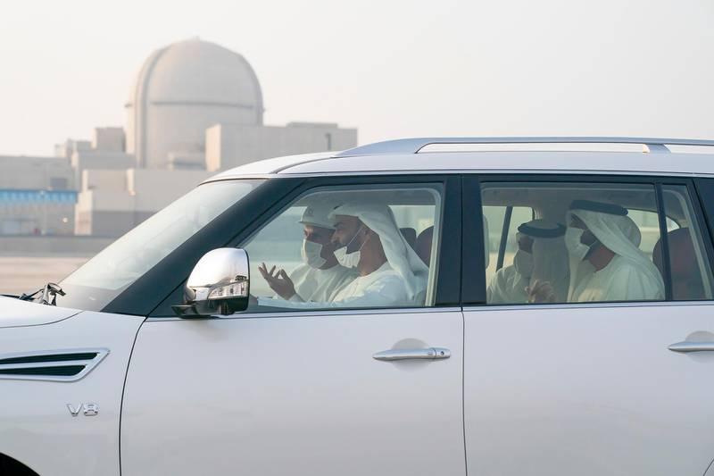 AL DHAFRA, ABU DHABI, UNITED ARAB EMIRATES - June 11, 2020: HH Sheikh Mohamed bin Zayed Al Nahyan, Crown Prince of Abu Dhabi and Deputy Supreme Commander of the UAE Armed Forces (R in vehicle) inspects the Barakah Peaceful Nuclear Energy Plants, in Barakah. Seen with HE Khaldoon Khalifa Al Mubarak, CEO and Managing Director Mubadala, Chairman of the Abu Dhabi Executive Affairs Authority and Abu Dhabi Executive Council Member (L in vehicle), HH Sheikh Nahyan Bin Zayed Al Nahyan, Chairman of the Board of Trustees of Zayed bin Sultan Al Nahyan Charitable and Humanitarian Foundation (Back R in vehicle) and HH Sheikh Sultan bin Hamdan bin Mohamed Al Nahyan (Back L in vehicle).  ( Mohamed Al Hammadi / Ministry of Presidential Affairs ) ---