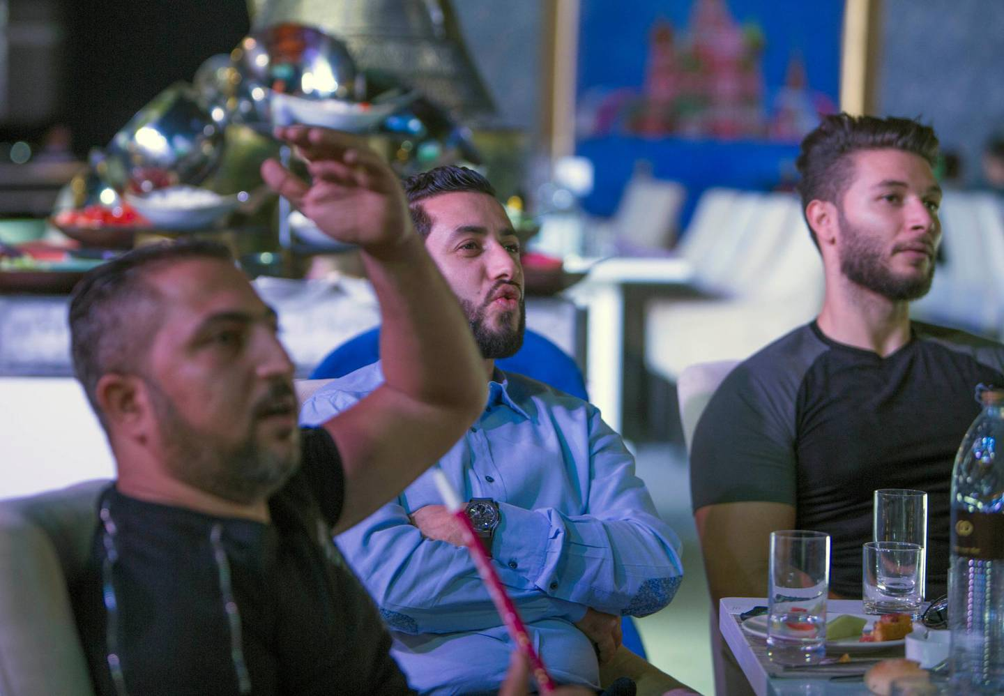 ABU DHABI, UNITED ARAB EMIRATES, 14 June 2018 - Football fans watching the games between Saudi and Russia at Sofitel Corniche tent in Abu Dhabi.  Leslie Pableo for The National story by Anna Zacharias