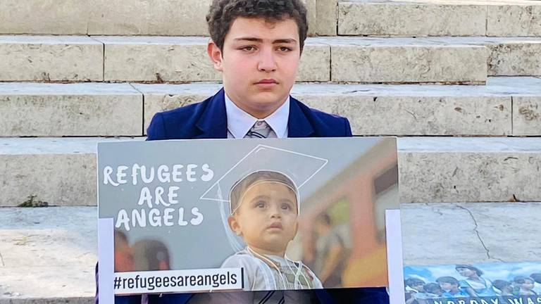 An image that illustrates this article Syrian boy protests outside UK Parliament to highlight plight of war victims