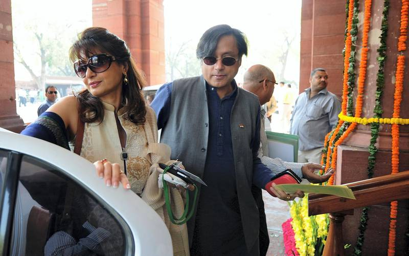 Ex-junior minister for external affairs and Congress Party's Member of Parliament Shashi Tharoor (R) with his wife Sunanda Pushkar arrive at parliament for the opening of the budget session in New Delhi on March 12, 2012. Budget session for the Indian parliament began with the general budget to be tabled on March 16. AFP PHOTO/ Prakash SINGH / AFP PHOTO / PRAKASH SINGH