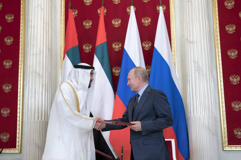 MOSCOW, RUSSIA - June 01, 2018: HH Sheikh Mohamed bin Zayed Al Nahyan, Crown Prince of Abu Dhabi and Deputy Supreme Commander of the UAE Armed Forces (L) and  HE Vladimir Putin Vladimirovich, President of Russia (R) exchange documents after the signing of a memorandum of understanding, at the Kremlin Palace.  ( Mohamed Al Hammadi / Crown Prince Court - Abu Dhabi ) ---