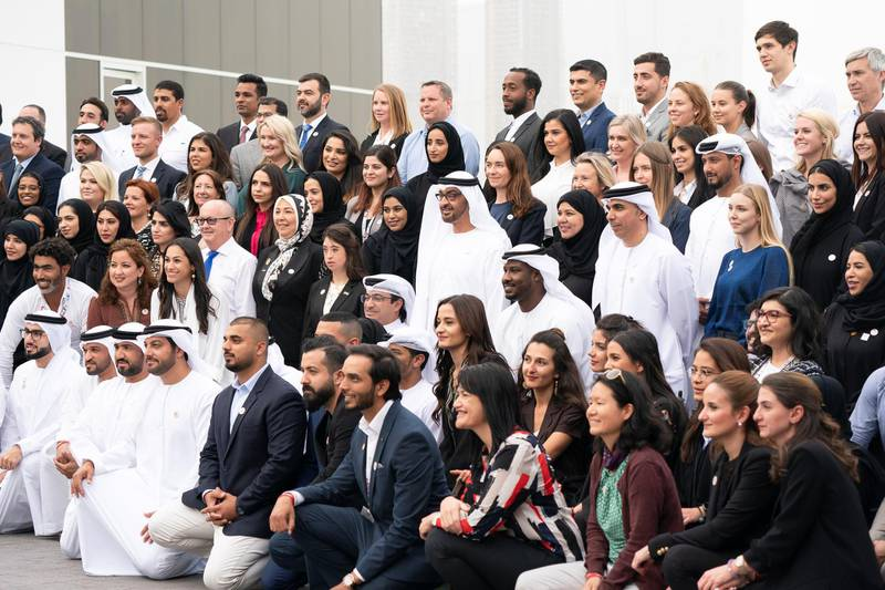 ABU DHABI, UNITED ARAB EMIRATES - March 25, 2019: HH Sheikh Mohamed bin Zayed Al Nahyan Crown Prince of Abu Dhabi Deputy Supreme Commander of the UAE Armed Forces (2nd row centre), stands for a group photograph with Special Olympics World Games Abu Dhabi 2019 organisers, during a Sea Palace barza.   ( Saeed Al Mehairi / Ministry of Presidential Affairs )---