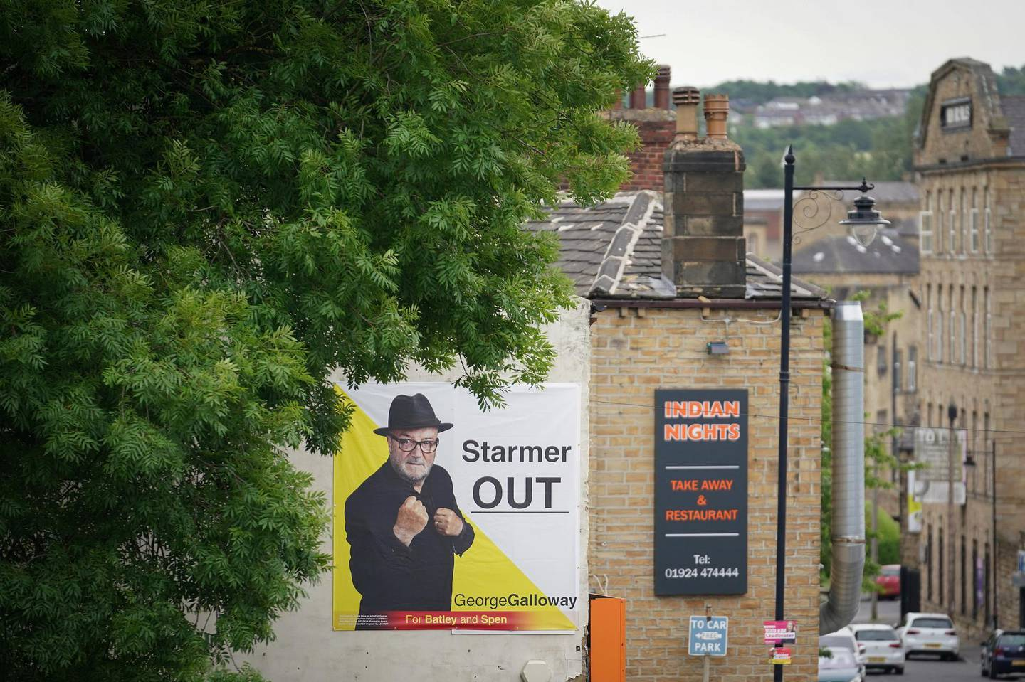 BATLEY, ENGLAND - JUNE 14:  A campaign poster for Workers Party of Britain candidate George Galloway adorns a house in the Batley and Spen constituency on June 14, 2021 in Batley, England.  (Photo by Christopher Furlong/Getty Images)