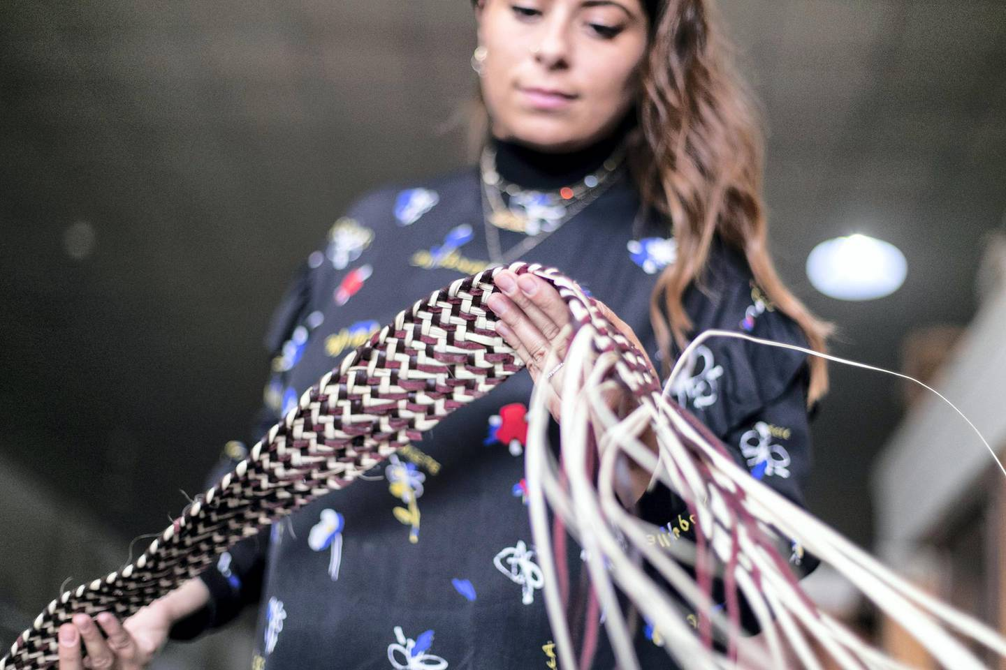 SHARJAH, UNITED ARAB EMIRATES. 7 SEPTEMBER 2019. Lana El Samman inspects a khoos sample.Lana El Samman is currently a resident designer in Tashkeel's Tanween program. The program is open to emerging designers, makers and artisans living and working in the UAE.Lana El Samman is of Lebanese origin, and grew up in Beirut and later Canada, where she studied interior design followed by a Master's degree at the Florence Institute of Design, Italy. Her career began as a teaching assistant at the American University of Sharjah before joining Sharjah Art Foundation, which has been her home for the past eight years working as an interior designer and then progressing to become a significant member of the production programme. In the SAF Production Programme, Samman has had the chance to further her furniture design practice and create pieces used by the Foundation for various events.(Photo: Reem Mohammed/The National)Reporter: KATE HAZELLSection: WK