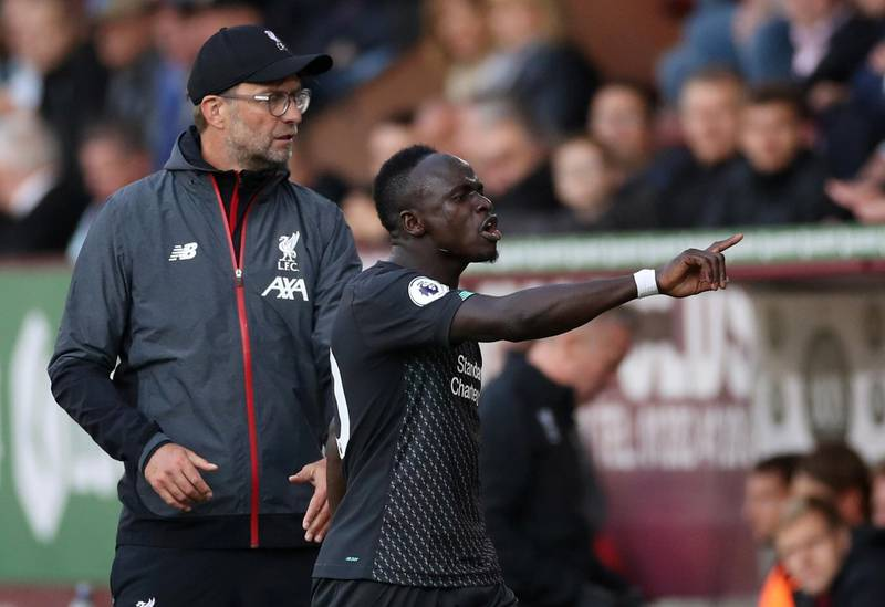 """Soccer Football - Premier League - Burnley v Liverpool - Turf Moor, Burnley, Britain - August 31, 2019  Liverpool's Sadio Mane reacts after being substituted off as manager Juergen Klopp looks on  Action Images via Reuters/Carl Recine  EDITORIAL USE ONLY. No use with unauthorized audio, video, data, fixture lists, club/league logos or """"live"""" services. Online in-match use limited to 75 images, no video emulation. No use in betting, games or single club/league/player publications.  Please contact your account representative for further details."""