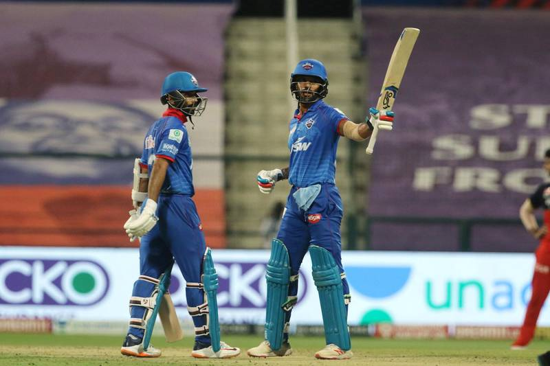 Shikhar Dhawan of Delhi Capitals raises his bat after scoring a fifty during match 55 of season 13 of the Dream 11 Indian Premier League (IPL) between the Delhi Capitals and the Royal Challengers Bangalore at the Sheikh Zayed Stadium, Abu Dhabi in the United Arab Emirates on the 2nd November 2020.  Photo by: Vipin Pawar  / Sportzpics for BCCI