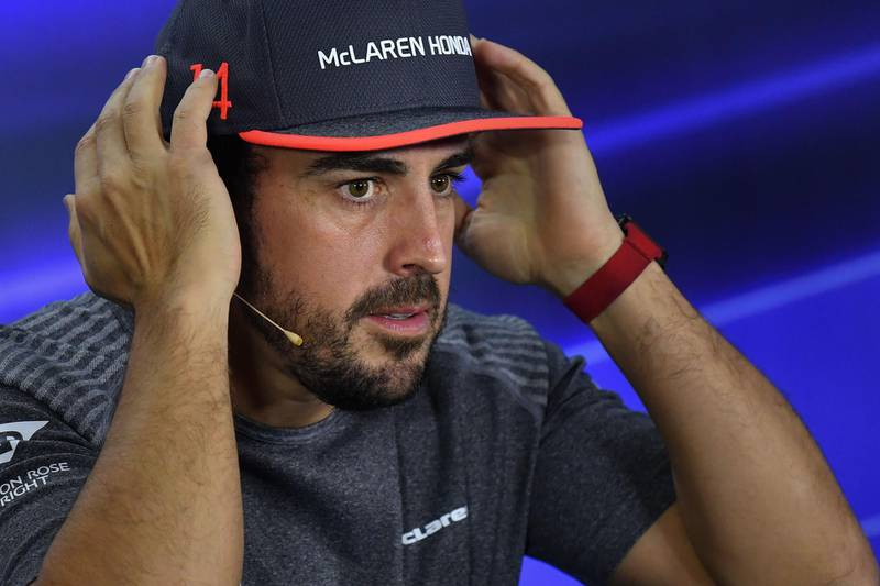 (FILES) This file photo taken on November 23, 2017 shows McLaren's Spanish driver Fernando Alonso attend the drivers' press conference ahead of the Abu Dhabi Formula One Grand Prix at the Yas Marina circuit. Two time ex world champion Fernando Alonso will make his Le Mans 24-hour race debut this year after getting permission to take a leave of absence from Formula One by his team McLaren. / AFP PHOTO / Andrej ISAKOVIC