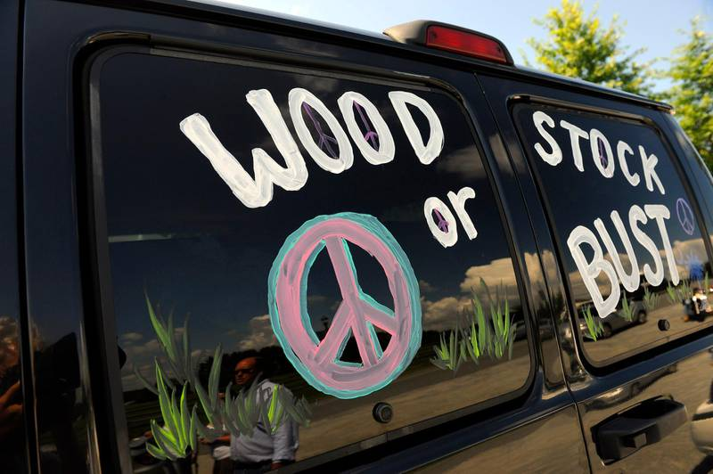 """FILE - This Aug. 14, 2009 file photo shows a van decorated with """"Woodstock or Bust"""" at the original Woodstock Festival site in Bethel, N.Y.   Woodstock 50 is officially cancelled. Organizers announced Wednesday, July 31, 2019 that the troubled festival that hit a series of setbacks in the last four months won't take place next month. The three-day festival was originally scheduled for Aug. 16-18, but holdups included permit denials and the loss of a financial partner and a production company.(AP Photo/Stephen Chernin, File)"""