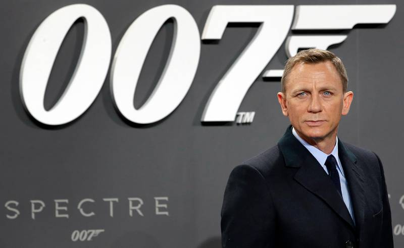 """FILE - This is a Wednesday, Oct. 28, 2015 file photo of actor Daniel Craig poses for the media as he arrives for the German premiere of the James Bond movie 'Spectre' in Berlin, Germany. The release of the James Bond film """"No Time To Die"""" has been pushed back several months because of global concerns about coronavirus. MGM, Universal and producers Michael G. Wilson and Barbara Broccoli announced on Twitter Wednesday that the film would be pushed back from its April release to November 2020.  (AP Photo/Michael Sohn/File)"""