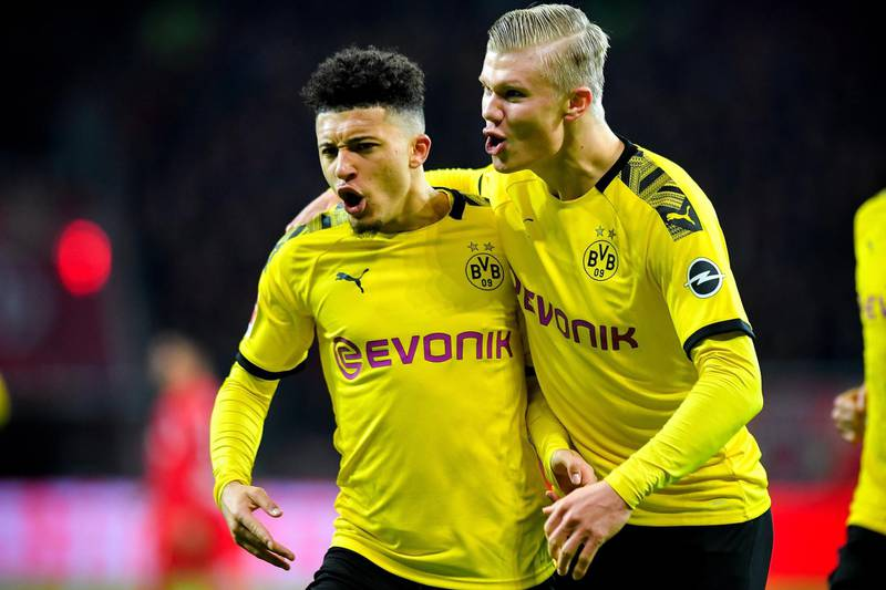epa08203609 Dortmund's Jadon Sancho (L) reacts with his teammate Erling Haaland (R) after scoring the 3-2 lead during the German Bundesliga soccer match between Bayer Leverkusen and Borussia Dortmund at BayArena in Leverkusen, Germany, 08 February 2020.  EPA/SASCHA STEINBACH CONDITIONS - ATTENTION: The DFL regulations prohibit any use of photographs as image sequences and/or quasi-video.