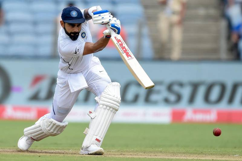 TOPSHOT - India's captain Virat Kohli plays a shot on the second day of the second Test cricket match between India and South Africa at the Maharashtra Cricket Association Stadium in Pune on October 11, 2019. ----IMAGE RESTRICTED TO EDITORIAL USE - STRICTLY NO COMMERCIAL USE-----  / AFP / PUNIT PARANJPE / ----IMAGE RESTRICTED TO EDITORIAL USE - STRICTLY NO COMMERCIAL USE-----