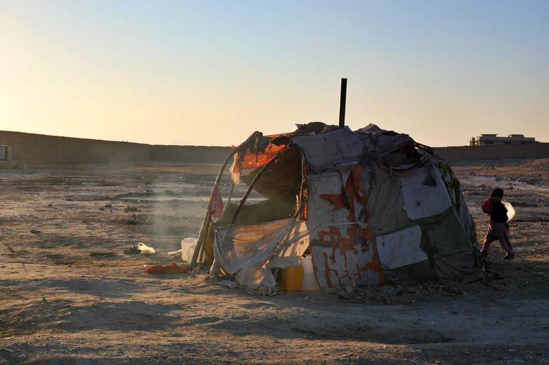 Pictured: A make-shift tent for one family inside an IDP camp on the outskirts of Kandahar City. Most of the 250 families in the camp have been supplied by UNHCR tents but not all. There is also a lack of blankets, bedding and food.  Photo by Charlie Faulkner January 2021